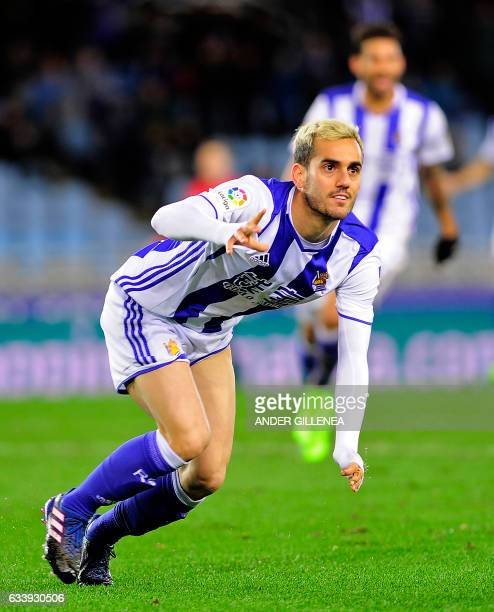Real Sociedad's midfielder Juanmi celebrates after scoring his team's third goal during the Spanish league football match Real Sociedad vs CA Osasuna...