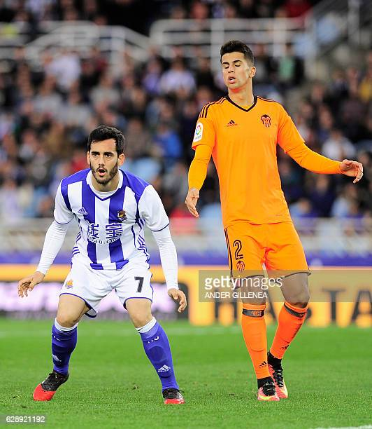 Real Sociedad's midfielder Juanmi gestures next to Valencia's Portuguese defender Joao Cancelo during the Spanish league football match Real Sociedad...