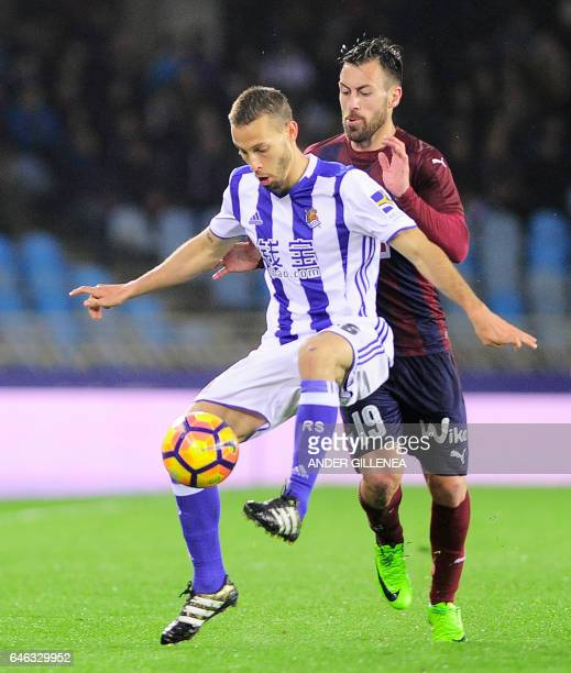 Real Sociedad's midfielder Sergio Canales vies with Eibar's defender Antonio Luna during the Spanish league football match Real Sociedad vs SD Eibar...