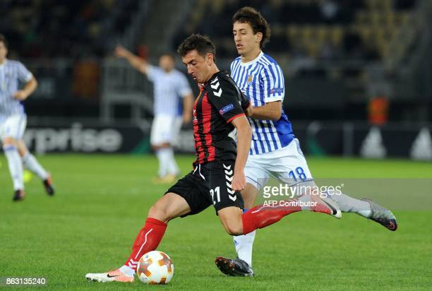Real Sociedad's Mikel Oyarzabal vies with Vardar's Levangenii Novak during the UEFA Europa League Group L football match between FK Vardar and Real...