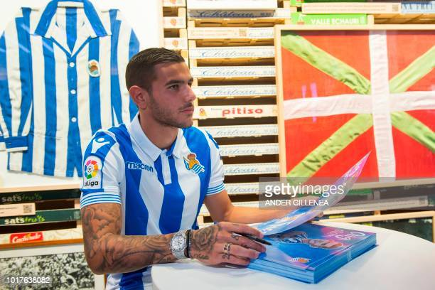 Real Sociedad's new French defender Theo Hernandez signs autographs during his official presentation in the Spanish Basque city of San Sebastian on...