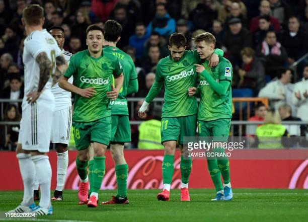 Real Sociedad's Norwegian midfielder Martin Odegaard celebrates his goal with Real Sociedad's Belgian forward Adnan Januzaj during the Spanish Copa...