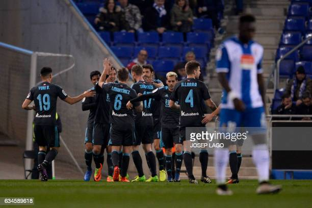 Real Sociedad's players celebrate a goal during the Spanish league football match RCD Espanyol vs Real Sociedad at the RCDE Stadium in Cornella de...
