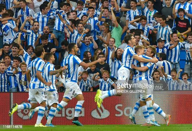Real Sociedad's players celebrate after Real Sociedad's Spanish defender Nacho Monreal scored a goal during the Spanish league football match Real...