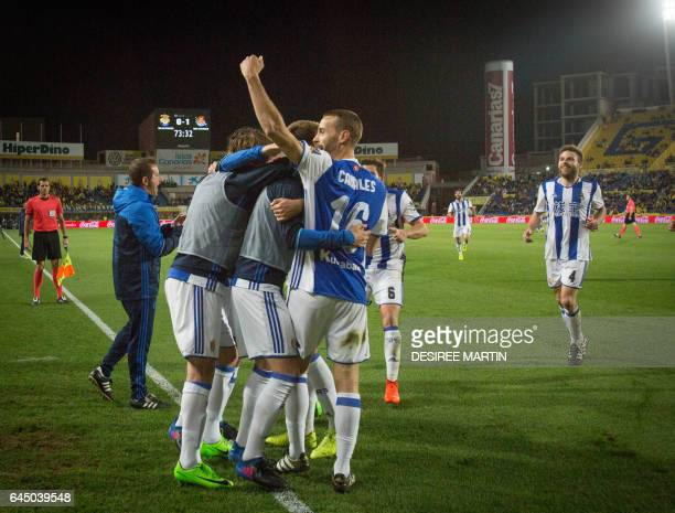 Real Sociedad's players celebrate after scoring during the Spanish league football match UD Las Palmas vs Real Sociedad at the Gran Canaria stadium...