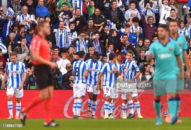Real Sociedad's players celebrate after Spanish forward Mikel Oyarzabal scored a goal during the Spanish league football match between Real Sociedad...