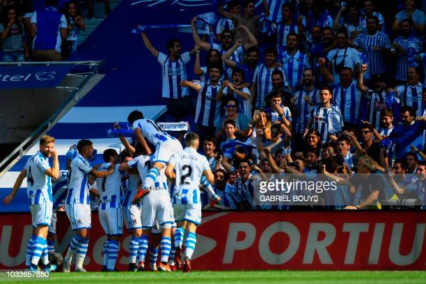 Real Sociedad's players celebrate after teammate Spanish defender Aritz Elustondo scored a goal during the Spanish league football match between Real...