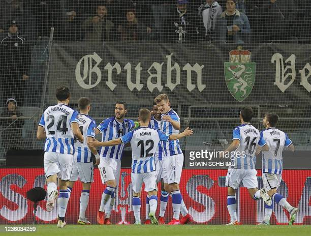 Real Sociedad's players celebrate during the UEFA Europa League group B football match between SK Sturm Graz and Real Sociedad de Futbol in Graz, on...
