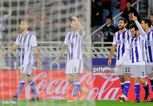 Real Sociedad's players celebrater after Real Sociedad's midfielder Juanmi scoring his team's third goal during the Spanish league football match...