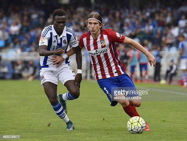 Real Sociedad's Portuguese midfielder Bruma vies with Atletico Madrid's Brazilian defender Filipe Luis during the Spanish league football match Real...