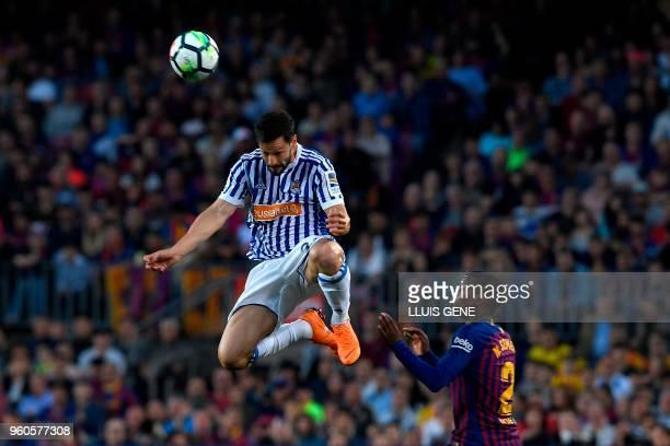 Real Sociedad's Spanish defender Alberta De la Bella heads the ball next to Barcelona's Portuguese defender Nelson Semedo during the Spanish league...