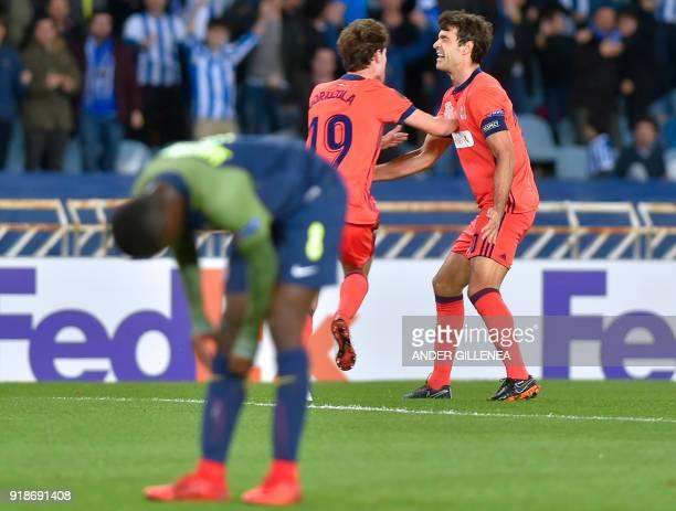 Real Sociedad's Spanish defender Alvaro Odriozola celebrates a goal with Real Sociedad's Spanish midfielder Xabier Prieto during the UEFA Europa...