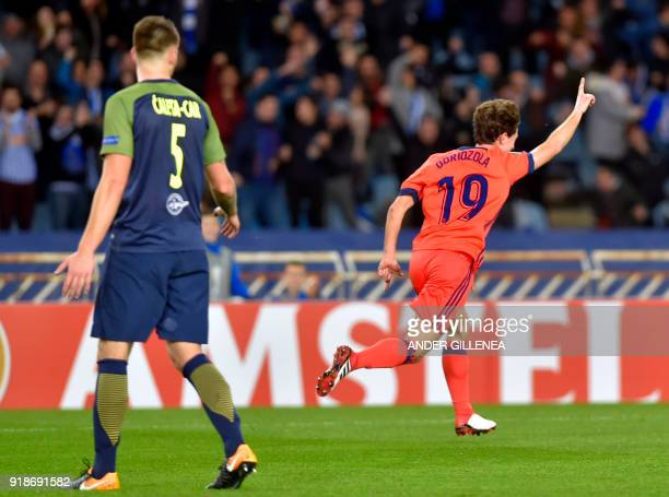 Real Sociedad's Spanish defender Alvaro Odriozola celebrates a goal during the UEFA Europa League first leg round of 32 football match between Real...