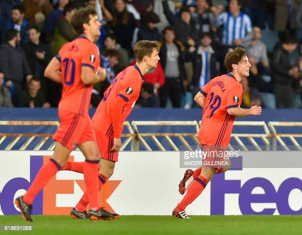 Real Sociedad's Spanish defender Alvaro Odriozola celebrates scoring a goal during the UEFA Europa League first leg round of 32 football match...