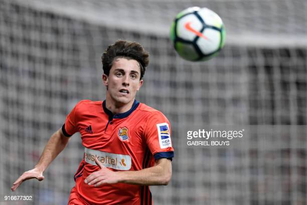 Real Sociedad's Spanish defender Alvaro Odriozola eyes the ball during the Spanish league football match between Real Madrid CF and Real Sociedad at...