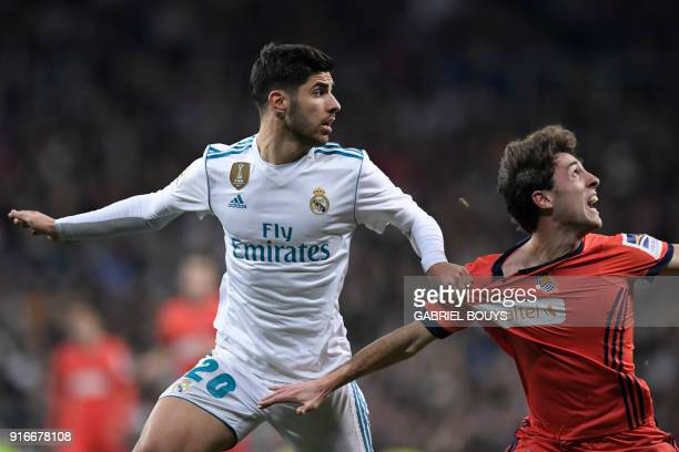 Real Sociedad's Spanish defender Alvaro Odriozola vies with Real Madrid's Spanish midfielder Marco Asensio during the Spanish league football match...
