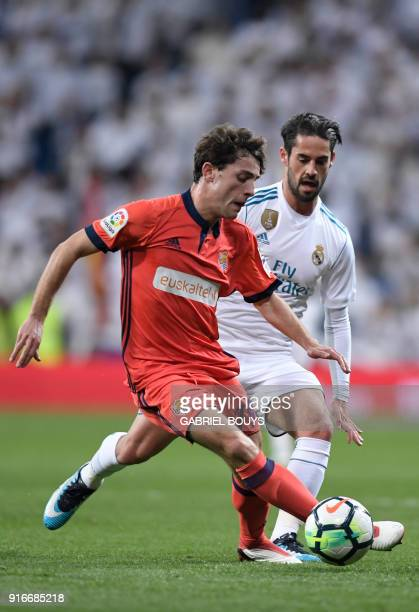 Real Sociedad's Spanish defender Alvaro Odriozola vies with Real Madrid's Spanish midfielder Isco during the Spanish league football match between...