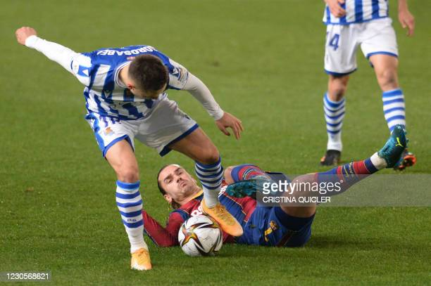 Real Sociedad's Spanish defender Andoni Gorosabel vies with Barcelona's French midfielder Antoine Griezmann during the Spanish Super Cup semi final...