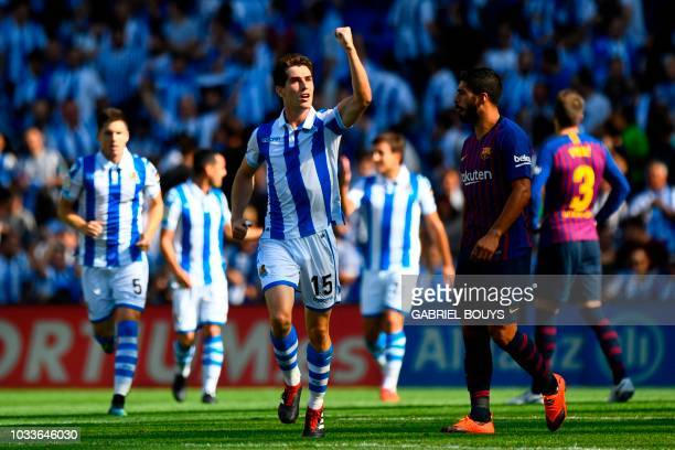 Real Sociedad's Spanish defender Aritz Elustondo celebrates after scoring a goal during the Spanish league football match between Real Sociedad and...