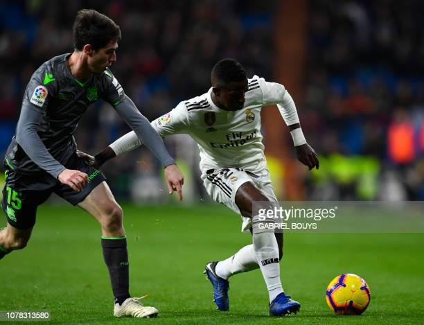 Real Sociedad's Spanish defender Aritz Elustondo vies with Real Madrid's Brazilian forward Vinicius Junior during the Spanish League football match...