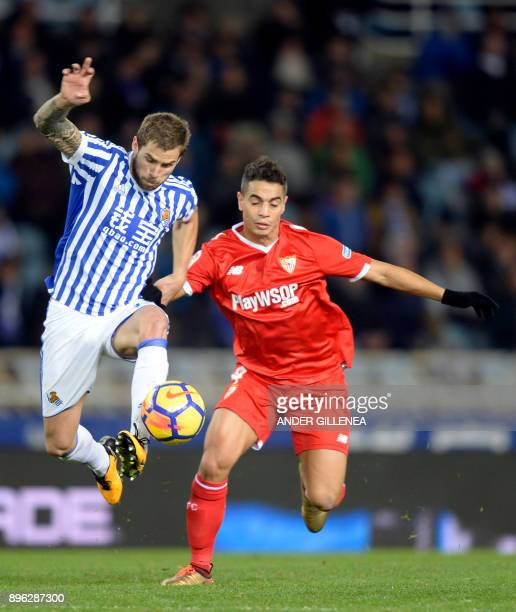 Real Sociedad's Spanish defender Inigo Martinez Berridi vies with Sevilla's French forward Wissam Ben Yedder during the Spanish league football match...