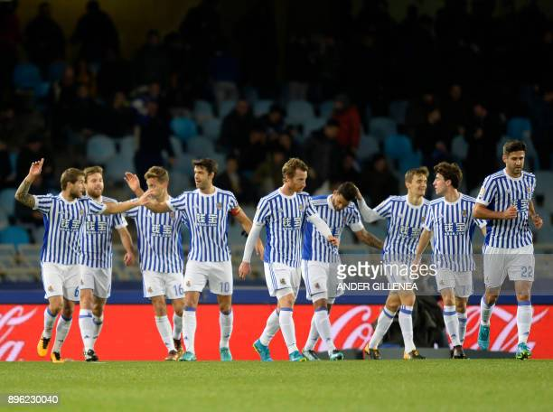 Real Sociedad's Spanish defender Inigo Martinez celebrates a goal with teammates during the Spanish league football match Real Sociedad vs Sevilla FC...