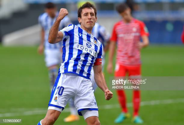Real Sociedad's Spanish forward Mikel Oyarzabal celebrates his goal during the Spanish League football match between Real Sociedad and Granada at the...