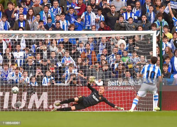 Real Sociedad's Spanish forward Mikel Oyarzabal scores a penalty during the Spanish league football match between Real Sociedad and FC Barcelona at...