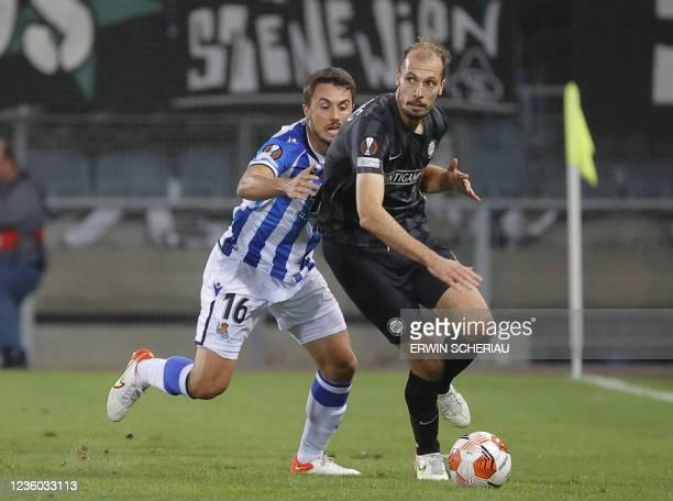 Real Sociedad's Spanish midfielder Ander Guevara and Sturm Graz's Slovenian defender Jon Gorenc-Stankovic vie for the ball during the UEFA Europa...