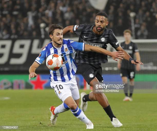 Real Sociedad's Spanish midfielder Ander Guevara and Sturm Graz's Swiss defender Gregory Wuethrich vie for the ball during the UEFA Europa League...