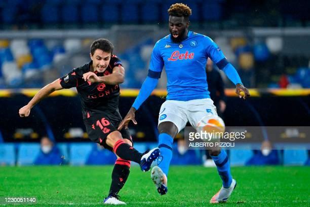 Real Sociedad's Spanish midfielder Ander Guevara shoots on goal despite Napoli's French midfielder Tiemoue Bakayoko during the UEFA Europa League...