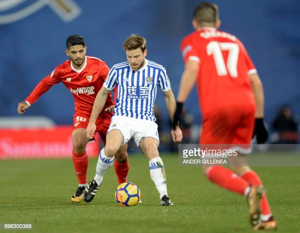 Real Sociedad's Spanish midfielder Asier Illarramendi vies with Sevilla's Argentinian midfielder Ever Banega during the Spanish league football match...