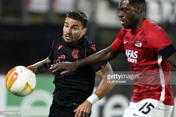 Real Sociedad's Spanish midfielder Cristian Portu and AZ Alkmaar's Dutch defender Bruno Martins Indi fight for the ball during the UEFA Europa League...
