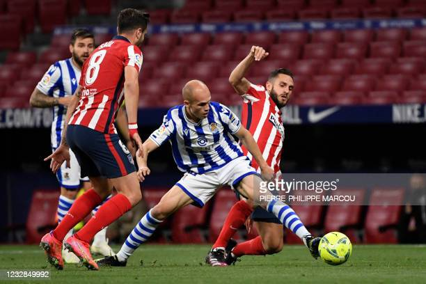 Real Sociedad's Spanish midfielder Jon Guridi vies with Atletico Madrid's Spanish midfielder Koke during the Spanish league football match Club...