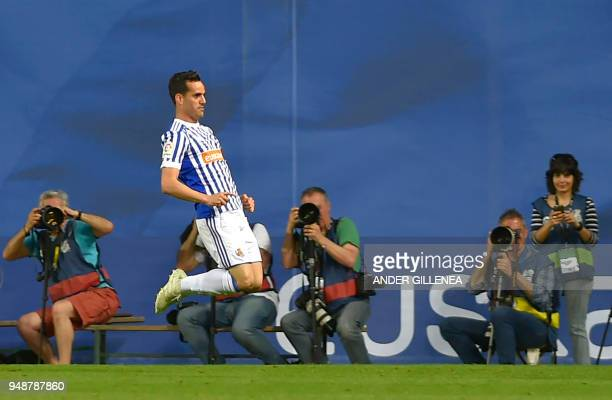 Real Sociedad's Spanish midfielder Juanmi jumps to celebrate scoring his team's second goal during the Spanish league football between Real Sociedad...
