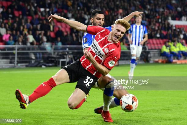 Real Sociedad's Spanish midfielder Mikel Merino fights for the ball with PSV Eindhoven's Belgian Yorbe Vertessen during the UEFA Europa League Group...