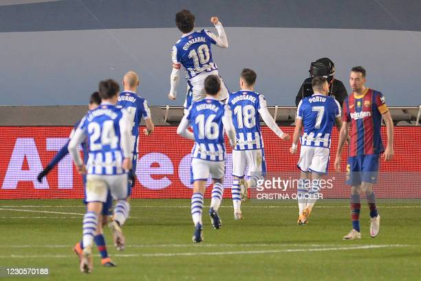 Real Sociedad's Spanish midfielder Mikel Oiarzabal celebraes his goal during the Spanish Super Cup semi final football match between Real Sociedad...