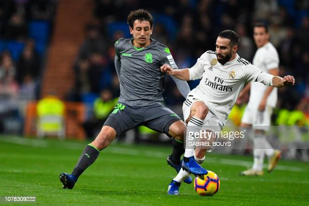 Real Sociedad's Spanish midfielder Mikel Oyarzabal vies with Real Madrid's Spanish defender Dani Carvajal during the Spanish League football match...
