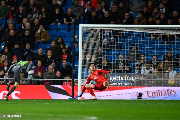 Real Sociedad's Spanish midfielder Ruben Pardo Gutierrez scores their second goal during the Spanish League football match between Real Madrid CF and...