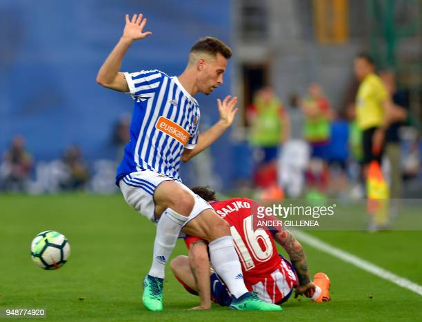 Real Sociedad's Spanish midfielder Sergio Canales vies with Atletico Atletico Madrid's Croatian defender Sime Vrsaljko during the Spanish league...