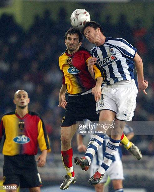 Real Sociedad's Xabi Alonso heads the ball next to Galatasaray's Penbe Ergun and Hasan Sas during their Champions League group D matchday six at...