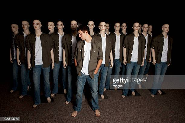 real - standing out in a crowd - fake man stock photos and pictures