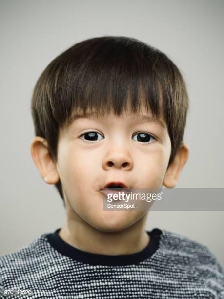 Real surprised kid looking at camera