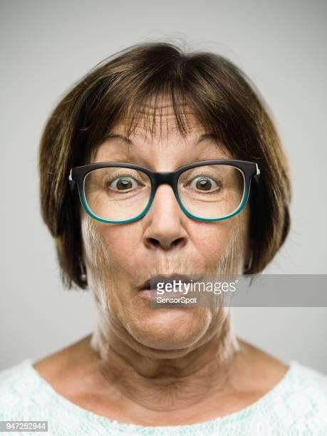 Real surprised senior woman portrait