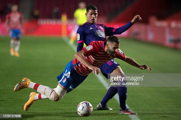 Real Valladolid's Brazilian forward Marcos Andre fouls Granada's French midfielder Maxime Gonalons during the Spanish League football match between...