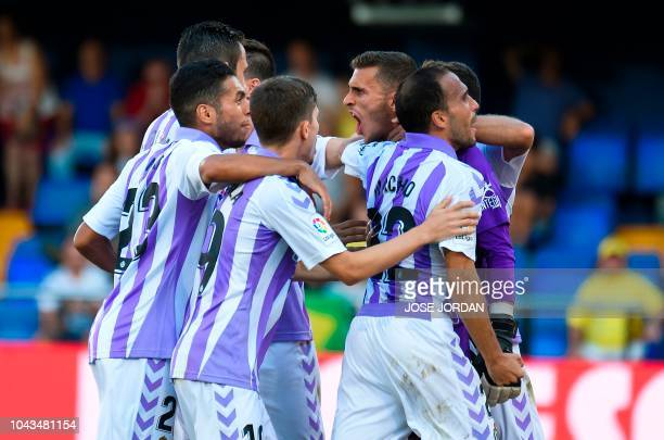Real Valladolid's Spanish goalkeeper Jordi Masip celebrates with teammates after stopping a penalty during the Spanish league football match...