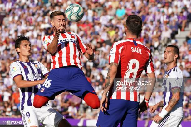 TOPSHOT Real Valladolid's Turkish forward Enes Unal vies with Atletico Madrid's Mexican midfielder Hector Herrera during the Spanish league football...