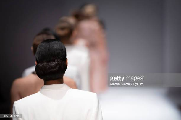 real view of models walking on stage - catwalk stock pictures, royalty-free photos & images