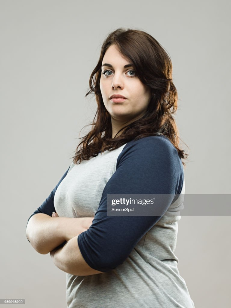 Real woman posing confidently in studio : Stock Photo
