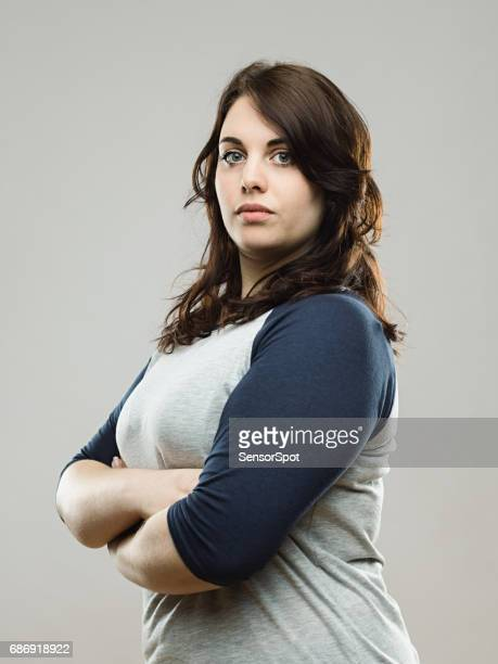 Real woman posing confidently in studio